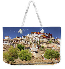Weekender Tote Bag featuring the photograph Thikse Monastery by Alexey Stiop