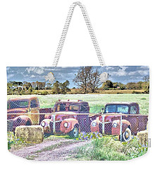 Weekender Tote Bag featuring the photograph Three 1940 Ford Pickups For Sale by Janette Boyd