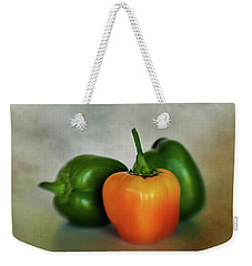 Weekender Tote Bag featuring the photograph Three Bell Peppers by David and Carol Kelly