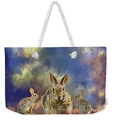Weekender Tote Bag featuring the photograph Three Scared Lagomorphs by Janette Boyd