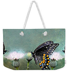 Weekender Tote Bag featuring the photograph Three Swallowtail Butterflies by Barbara Chichester