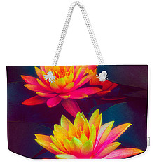 Weekender Tote Bag featuring the photograph Three Waterlilies by Chris Lord