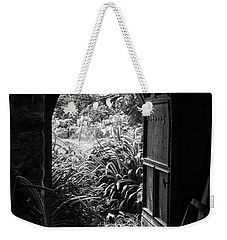 Weekender Tote Bag featuring the photograph Through The Door by Clare Bambers