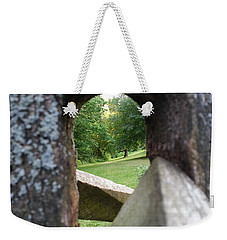 Weekender Tote Bag featuring the photograph Through The Post by Robert Knight