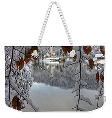 Weekender Tote Bag featuring the photograph Through The Snow Trees by Ian Middleton