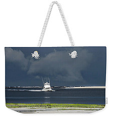 Weekender Tote Bag featuring the photograph Through The Storm by Phil Mancuso