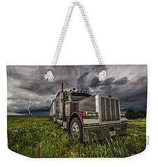 Weekender Tote Bag featuring the photograph Thunderstruck by Aaron J Groen