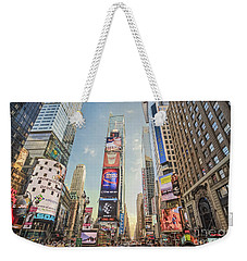 Weekender Tote Bag featuring the photograph Times Square Hustle by Ray Warren