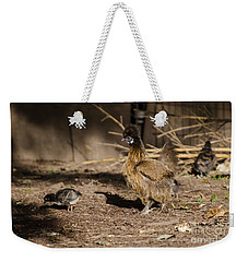 Weekender Tote Bag featuring the photograph Tiny And Babies by Donna Brown