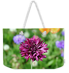 Weekender Tote Bag featuring the photograph Tiny Flower by Arthur Fix