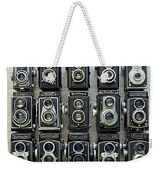 Weekender Tote Bag featuring the photograph Tlr Cameras by Keith Hawley