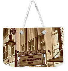 Weekender Tote Bag featuring the photograph To The Movies by Skip Willits