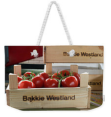 Weekender Tote Bag featuring the photograph Tomatoes In A Crate by Hans Engbers