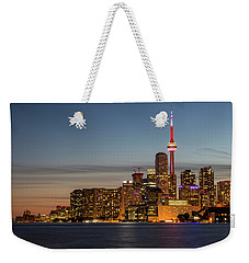 Weekender Tote Bag featuring the photograph Toronto Skyline At Dusk by Adam Romanowicz