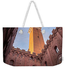 Weekender Tote Bag featuring the photograph Torre Del Mangia Siena Italy by Joan Carroll