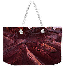 Weekender Tote Bag featuring the photograph Tortured Stone by Dustin LeFevre