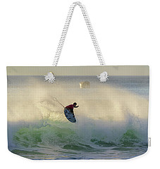 Weekender Tote Bag featuring the photograph Touch The Sun by Thierry Bouriat