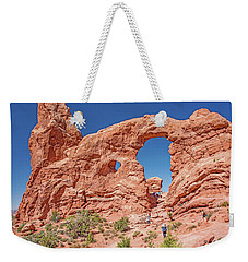 Weekender Tote Bag featuring the photograph Tourists On Sandstone Arch Formation, Arches National Park by A Gurmankin