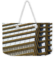 Weekender Tote Bag featuring the photograph Towering Windows by Karol Livote