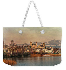 Weekender Tote Bag featuring the photograph Town Of Roses by Hanny Heim
