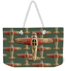 Weekender Tote Bag featuring the photograph Toy Airplane Scrapper Pattern by YoPedro
