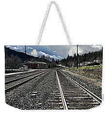 Weekender Tote Bag featuring the photograph Tracks by JoAnn Lense