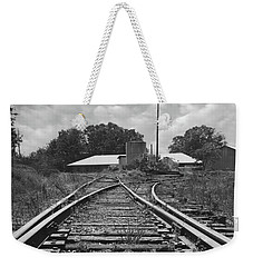 Weekender Tote Bag featuring the photograph Tracks by Mike McGlothlen