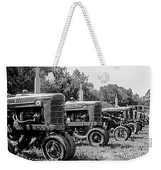 Weekender Tote Bag featuring the photograph Tractors by Brian Jones