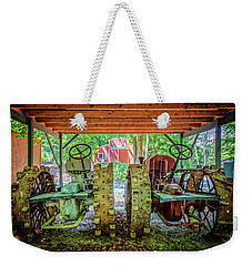 Weekender Tote Bag featuring the photograph Tractors Side By Side by Debra and Dave Vanderlaan