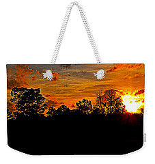 Weekender Tote Bag featuring the photograph Trailing Clouds Of Glory by Linda Brown