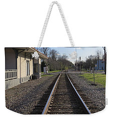 Weekender Tote Bag featuring the photograph Train Station View by Aaron Martens