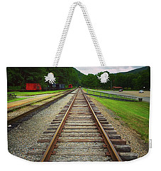 Weekender Tote Bag featuring the photograph Train Tracks by Linda Sannuti