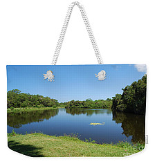 Weekender Tote Bag featuring the photograph Tranquil Lake by Gary Wonning