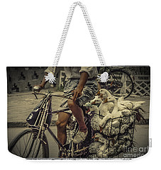Weekender Tote Bag featuring the photograph Transport By Bicycle In China by Heiko Koehrer-Wagner