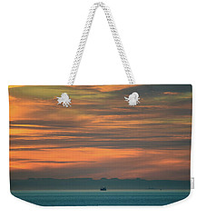 Weekender Tote Bag featuring the photograph Traveling Between Here And There by Ronda Broatch