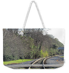 Weekender Tote Bag featuring the photograph Trax Bend by Aaron Martens