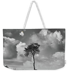 Weekender Tote Bag featuring the photograph Tree In A Field by Guy Whiteley
