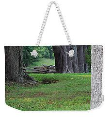 Weekender Tote Bag featuring the photograph Tree Line by Eric Liller