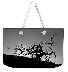 Weekender Tote Bag featuring the photograph Tree Of Light Silhouette Hillside - Black And White  by Matt Harang