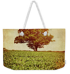 Weekender Tote Bag featuring the photograph Tree On Edge Of Field by Lyn Randle