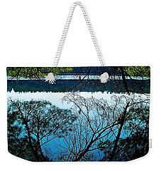 Weekender Tote Bag featuring the photograph Tree Overhang Reflected In The Water by Joy Nichols