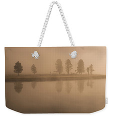 Weekender Tote Bag featuring the photograph Trees And Fog by Gary Lengyel