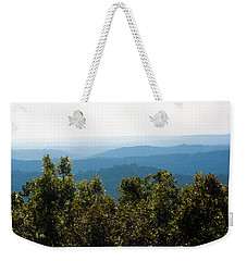 Weekender Tote Bag featuring the photograph Trees And Rolling Hills by Parker Cunningham