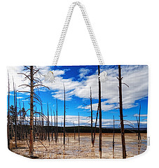 Weekender Tote Bag featuring the photograph Trees In The Midway Geyser Basin by Lars Lentz