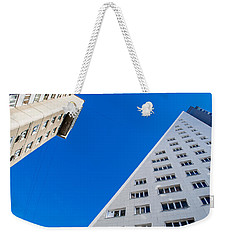 Weekender Tote Bag featuring the photograph Triangle Modern Building by John Williams
