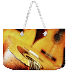 Weekender Tote Bag featuring the photograph Trio Of Acoustic Guitars by Lincoln Rogers