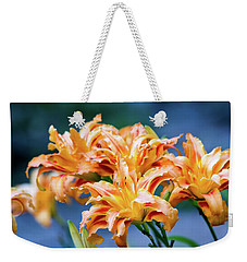 Weekender Tote Bag featuring the photograph Triple Lilies by Linda Segerson