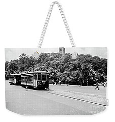 Weekender Tote Bag featuring the photograph Trolley With Cloisters by Cole Thompson