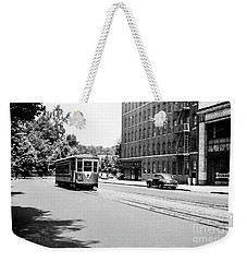 Weekender Tote Bag featuring the photograph Trolley With Packard Building  by Cole Thompson