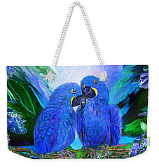Weekender Tote Bag featuring the mixed media Tropic Spirits - Hyacinth Macaws by Carol Cavalaris
